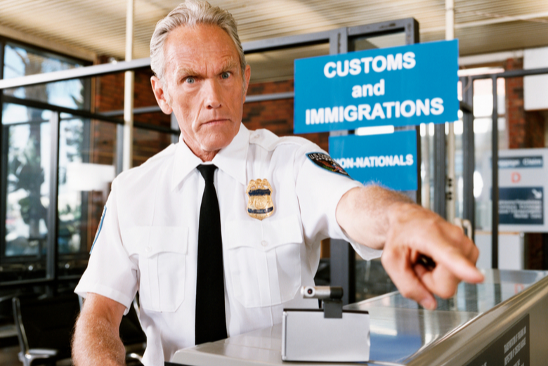 Airport security worker pointing
