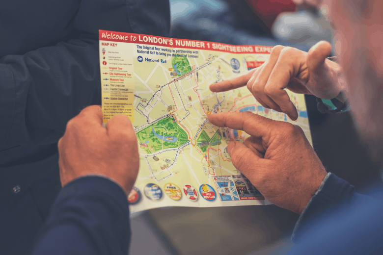 Two people pointing at map