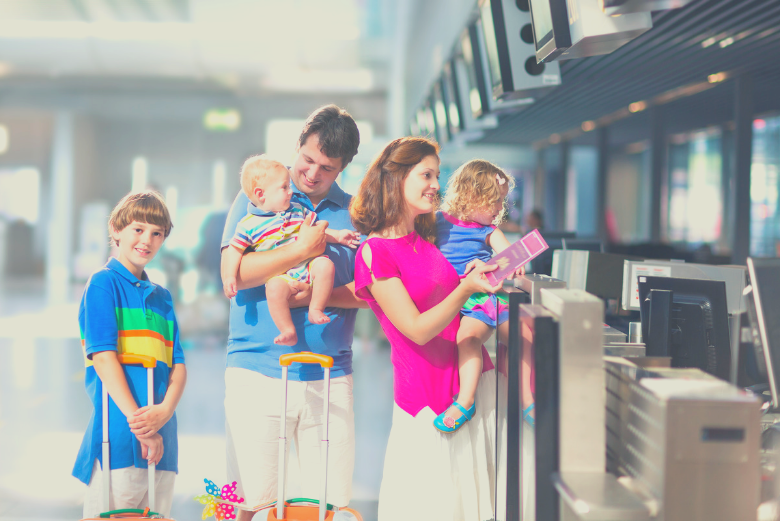 Family checking in at airport
