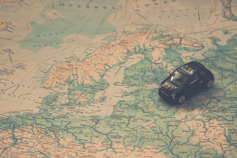 Miniature car placed on map