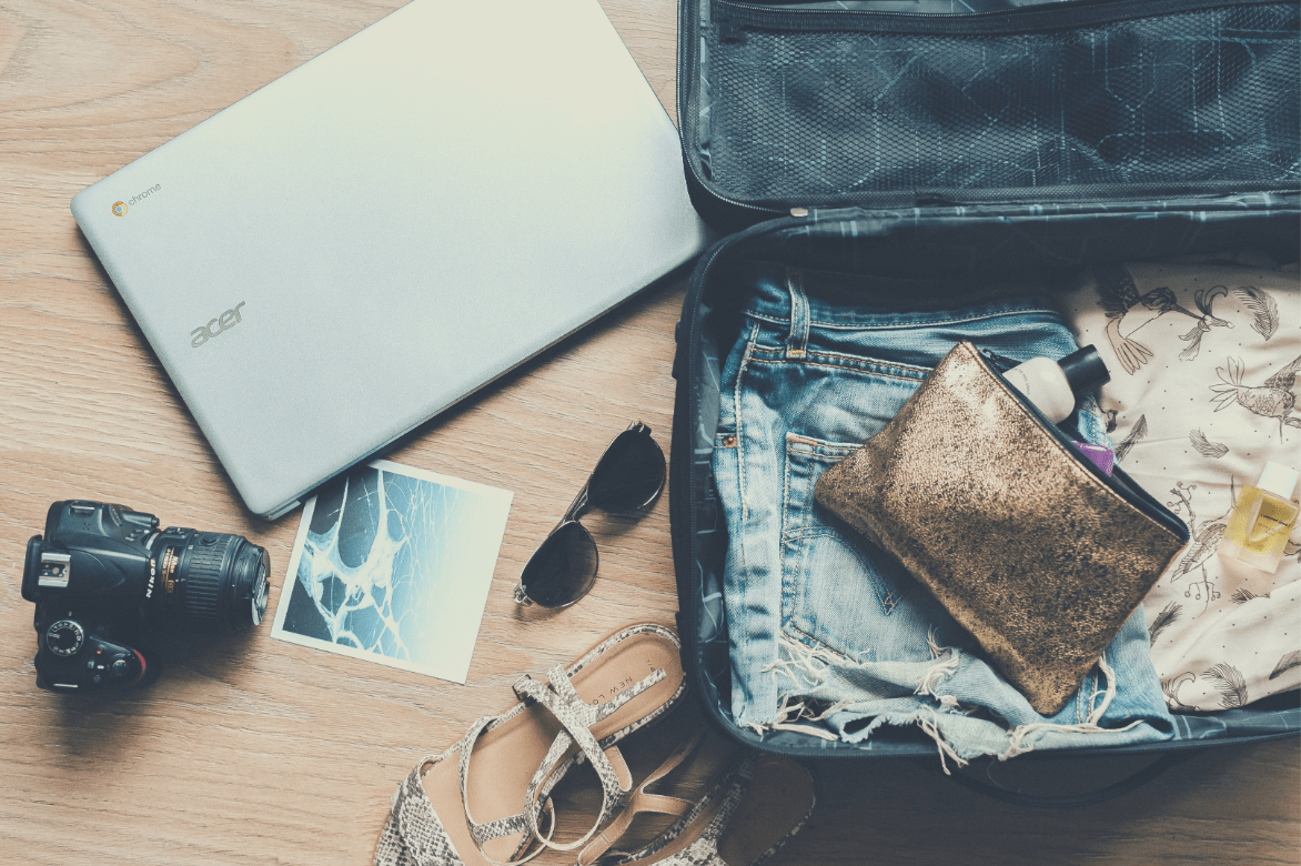 packing items spread out near suitcase