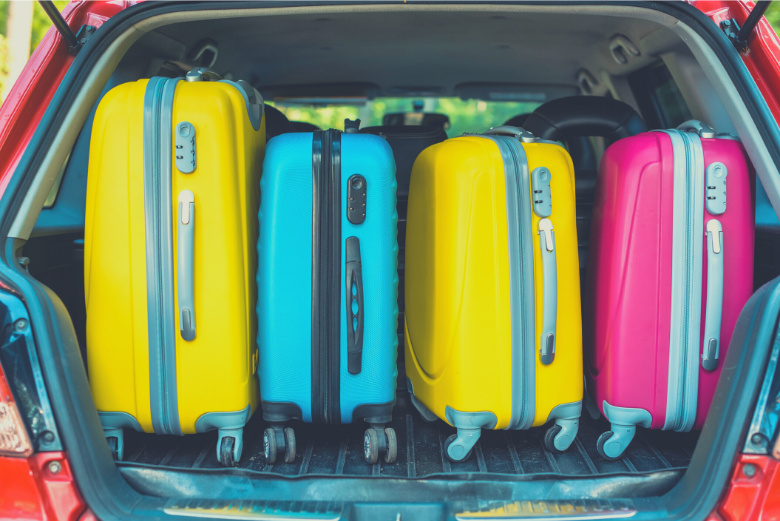 Different colored suitcases in car