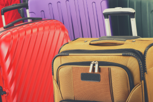Suitcases of different materials and colors